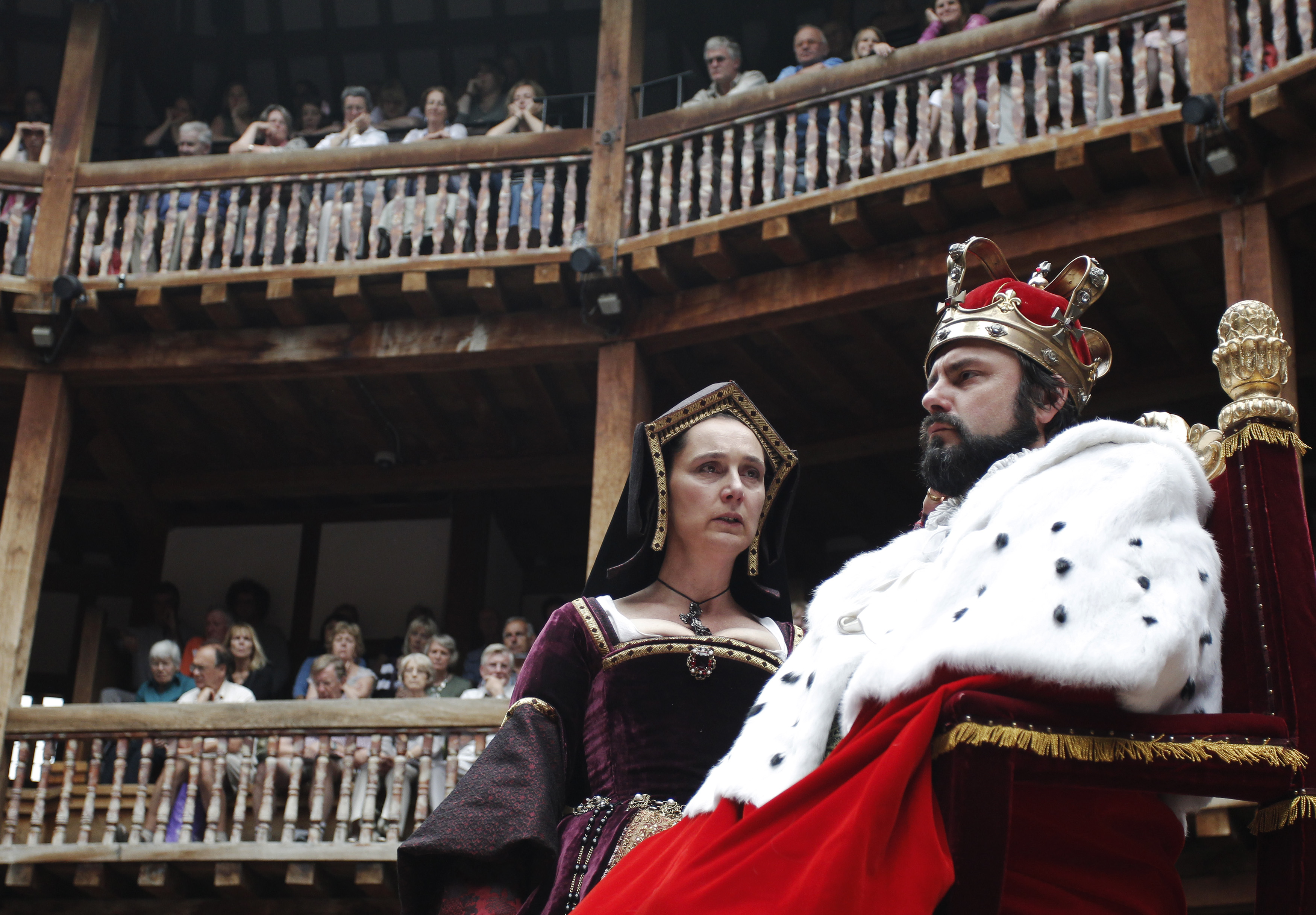 Actors Dominic Rowan and Kate Duchene  perform as Henry VIII and Queen Katherine in Shakepeare's Henry VIII at the Globe theatre in London